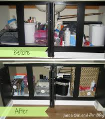organizing ideas for bathrooms bathroom use command hooks inside bathroom cabinet for storing