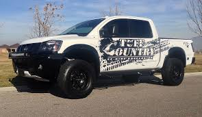 nissan titan cummins lifted raise your nissan titan or titan xd 4 inches with a lift kit by