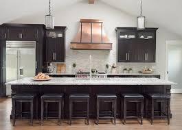 black kitchen cabinets with copper french hood transitional