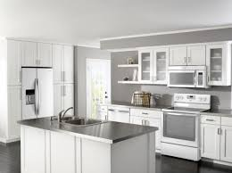 simple off white kitchen cabinets with white appliances has
