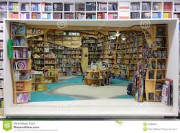 books and toys on shelves in a bookstore editorial image image