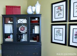 re styling my china cabinet posing as a library cabinet