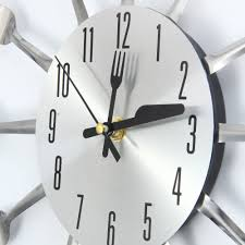 stainless steel wall clock umbra ribbon stainless steel wall