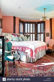colored walls bedroom with salmon colored walls aqua wing back chair oriental