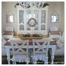 2perfection decor our holiday kitchen dining room i hung a simple grapevine wreath off my dining hutches knobs and draped a burlap joy banner off the wreaths twigs on top of our hutch i added faux