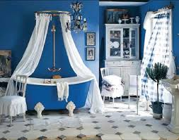 bathroom blue clawfoot tub matched with blue wall plus curtain