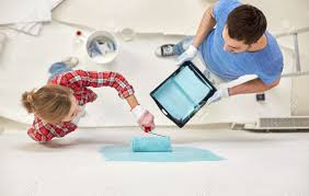 People Painting by Repair Building People Teamwork And Renovation Concept Couple