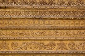 up ornamental wood carvings on the wall of monasteries in