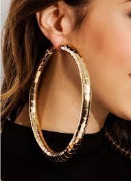 large earrings wearing the hoop earrings