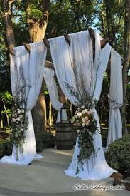 wedding arches rentals in houston tx burlap draping with country pink and green flowers a wooden