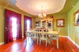 large luxury green dining room with cherry hardwood stock photo