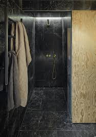 bathroom tile idea use the same tile on the floors and the walls black marble tiles on the floor walls and ceiling of this small bathroom coupled with the cold and black hardware give the space a luxurious look