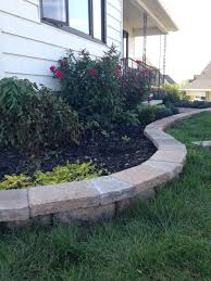 garden walls stone cut stone caps for a curved retaining wall pretty purple door