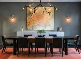 love how the branch chandelier blends with the wall art dining