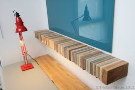 decor short floating bookshelves design with blue wall painting