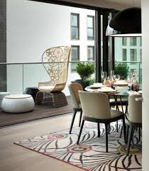 penthouse balcony dining room contemporary with wicker patio chair