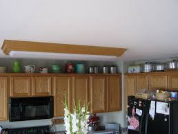 decorating ideas above kitchen cabinets space above kitchen cabinet decorating ideas home design ideas
