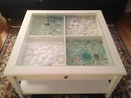 Glass Display Coffee Table Sea Glass Sand Dollars Displayed In A Glass Top Coffee Table