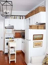 how to decorate space above kitchen cabinets decorating above kitchen cabinets what s in what s out in 2021