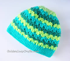 messy bun hat made with caron cakes yarn winter hat