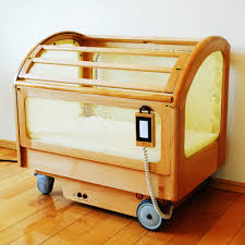 Baby Bed Crib Japanese Automatic Rocking Crib High Tech Always On The Edge