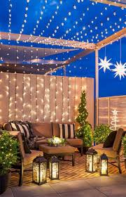 Decorating Decks And Patios Christmas String Lights And Lanterns Light Up A Balcony Deck Or