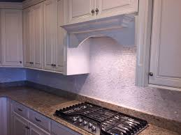 add an element of the sea to your kitchen with mother of pearl tile