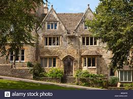 beautiful old cotswolds stone houses in the pretty old village of