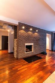 brick wall with fireplace and tv modern twist update before after