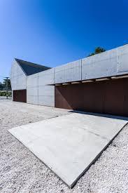 stark concrete funeral home by salas architecture tilts upwards