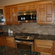 open kitchen with quartz counters and oak cabinets beautiful