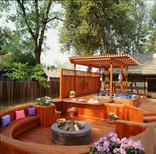 love this redwood deck with circular seating around the firepit