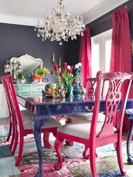 red dining table with white chairs floral wallpaper metallic
