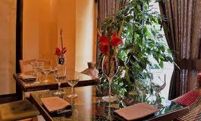 ristoranti zona porta venezia menu tipico africano con calice o bottiglia di vino al ristorante