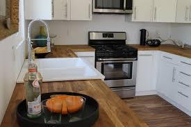 modern white kitchen cabinets wood floor modern white cabinets and acacia wood floor modern