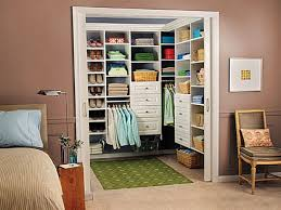 small walk in closet design with 8 tier open shelf shoe storage
