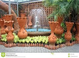 Nong Nooch Tropical Botanical Garden by A Fountain And Pots In The Nong Nooch Tropical Botanic Garden Near