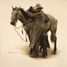 cowboy leading and stroking his horse flitner ranch shell
