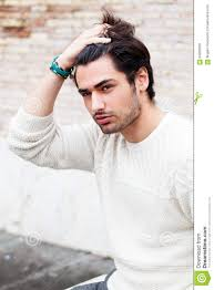 hair model boy cool young man fashion model hairstyle hand in the hair stock