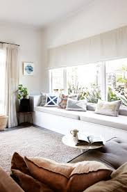 window seat height with cushion and carpets and curtain living