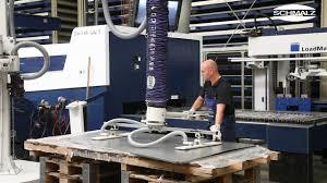 vacuum tube lifter jumboergo for ergonomic unloading of a laser