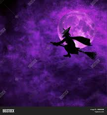 grunge background with silhouette of witch flying on a broom on