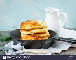 Cottage Cheese Dessert homemade cottage cheese pancakes in a cast iron frying pan
