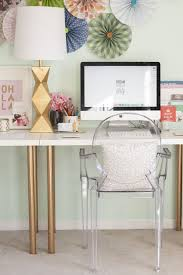 ikea hack studio desk with gold spray painted legs and a ghost chair