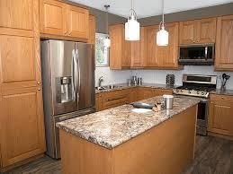 what color granite goes with golden oak cabinets visby golden oak klëarvūe cabinetry