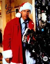 chevy chase signed christmas vacation standing next to tree 8x10
