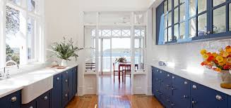blue cabinets white counter beach view yes please house