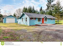 simple one story house exterior with blue and red trim stock photo