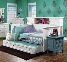 bedroom peel and tick wallpaper with ikea nightstand and daybeds