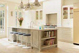 lovely kitchen counter stools with white trim glass upper cabinets